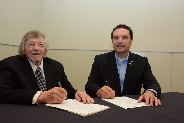 Paul West (L) and Lorenzo Ferrari (R) sign MRA in Vancouver.